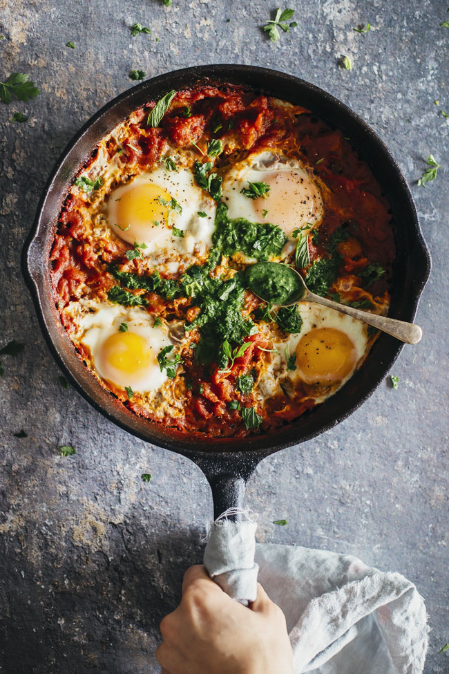 Shakshuka with hot aromatic herbs sauce called Zhoug #vegetarian | TheAwesomeGreen.com
