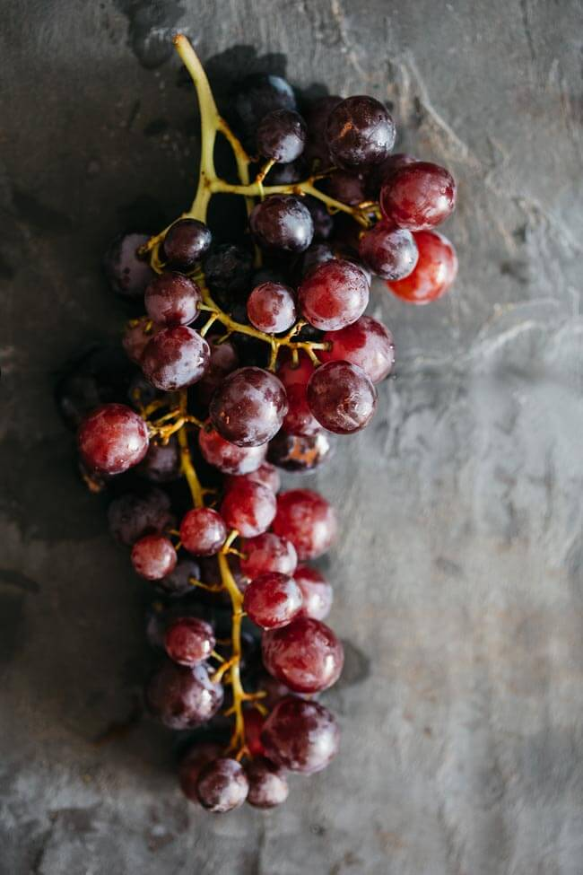 Fresh red grapes, an autumn delight and a key ingredient in my fall salad with roasted pumpkin | TheAwesomeGreen.com