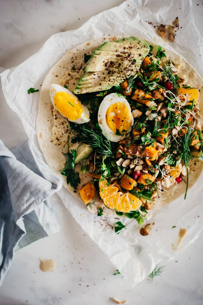 Filling lunch wrap with roasted sweet potato, egg, parsley and hummus | TheAwesomeGreen.com