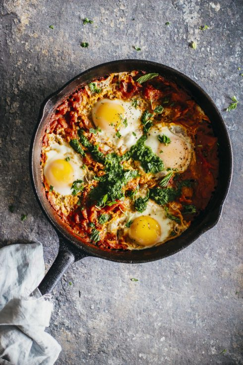 Shakshuka with Zhoug, a spicy green sauce made with aromatic herbs, originated from Yemen #breakfast #vegetarian   TheAwesomeGreen.com