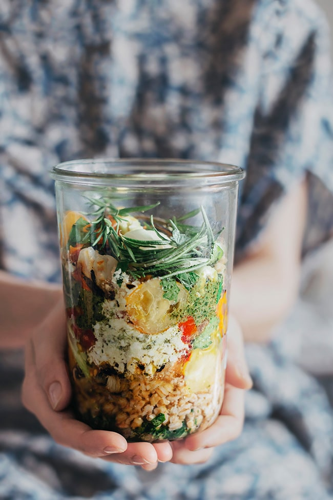 Layered summer salad with farro, grilled vegetables, feta and pesto #vegetarian | TheAwesomeGreen.com
