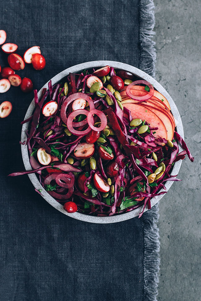 Sauerkraut salad with cranberries, beet and seeds for immune support and healthy gut #immunesupport #healthygut#raw #salad #sauerkraut #christmas #foodphotography #foodstyling | TheAwesomeGreen.com