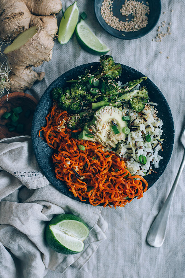 Sweet potato noodles bowl with broccoli, avocado and wild rice, plus ginger tamari dressing #vegan #spiralizer #spiralled #broccoli #sweetpotato #healthyrecipe #foodphotography #foodstyling | TheAwesomeGreen.com