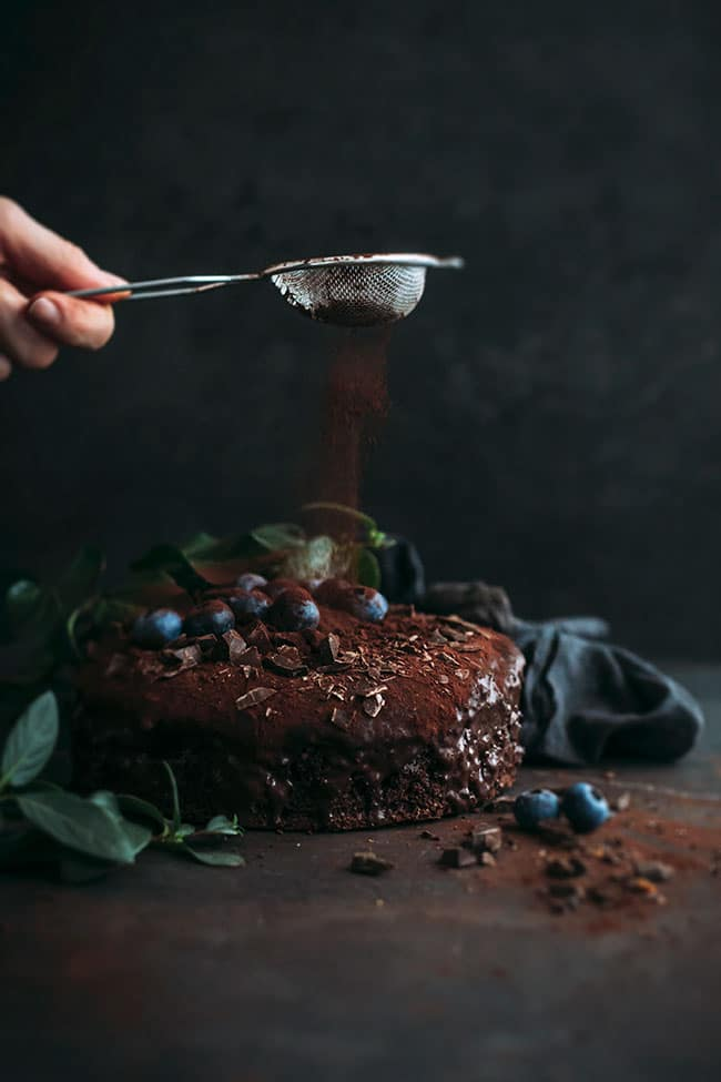 Moist vegan chocolate cake with blueberries #vegan #chocolate #chocolatecake #dessert #easy #foodstyling #foodphotography | TheAwesomeGreen.com