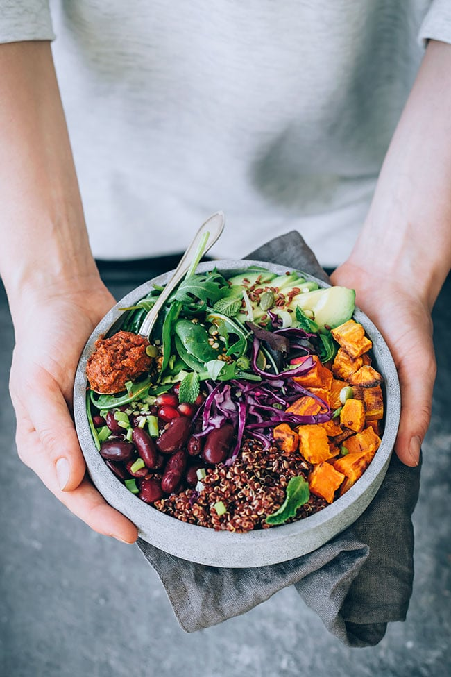 My favorite Buddha bowl, with red quinoa, sauerkraut and sun-dried tomato dressing #vegan #buddhabowl #winterbowl #salad #detox #healthy | TheAwesomeGreen.com