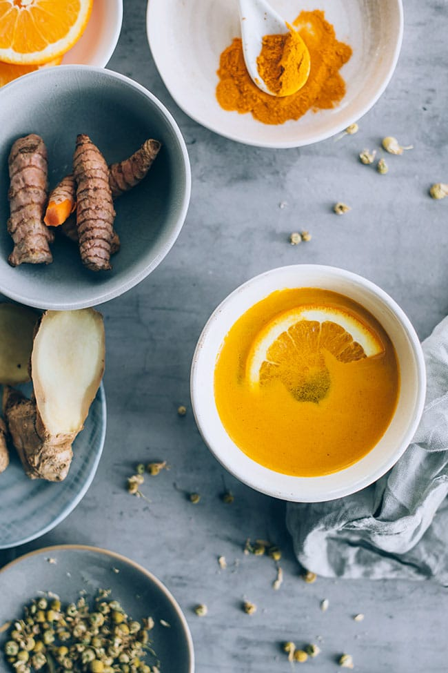 Healing ginger turmeric tea with orange and lemon juice #detox #healing #ayurveda #turmeric | TheAwesomeGreen.com