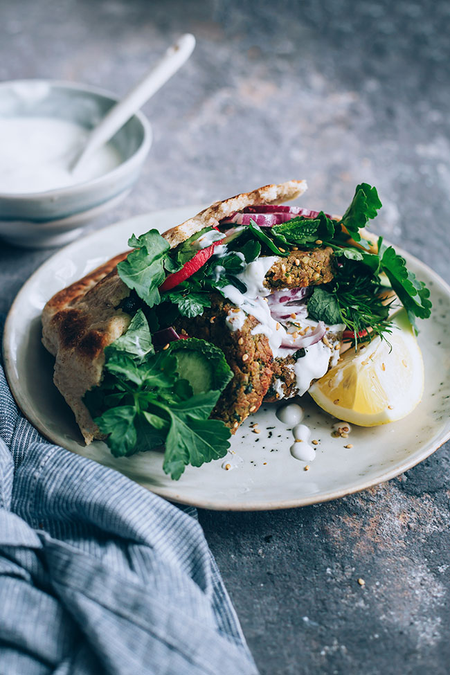 Homemade falafel sandwich with fresh aromatic herbs and yogurt tahini sauce #vegetarian #lunch #sandwich #falafel | TheAwesomeGreen.com