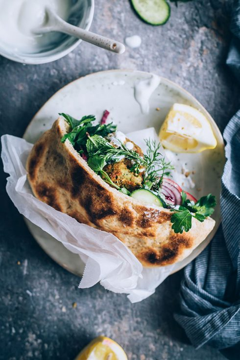 Falafel sandwich with pita bread and tahini sauce #vegetarian #lunch #sandwich #falafel   TheAwesomeGreen.com