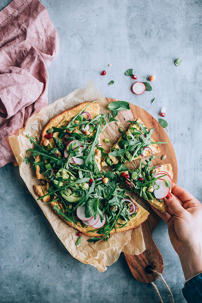 Chickpea pizza crust with asapragus and greens #glutenfree #pizza #asparagus #spring #vegan | TheAwesomeGreen.com